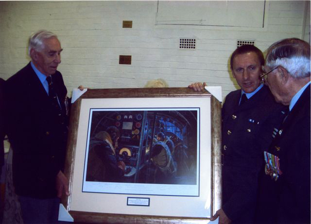 "Jack Watson and Harold Hernaman presenting a framed  ""We Guide to Strike"" to The Pathfinder Museum"